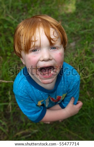 Big-Mouth Messy Kid - stock photo