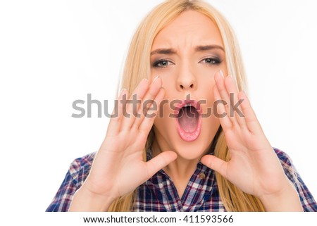 Big news! Woman holding hands near mouth and screaming