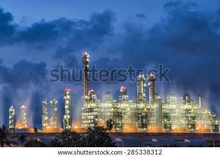 Big oil tanks in a refinery with treatment pond at industrial plants - stock photo