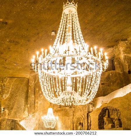 Big old chandelier in the main hall of Wieliczka Salt Mine - stock photo
