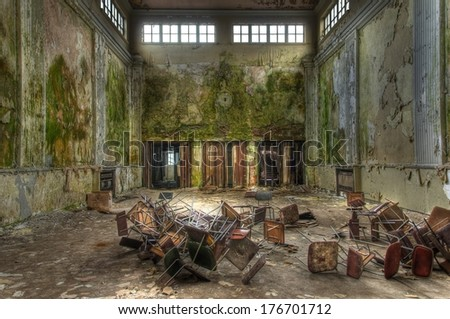 Big old hall with doors and chairs on the floor - stock photo