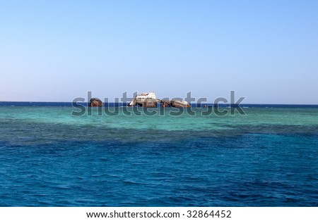 Big old rusty Shipwreck in the Red Sea's reef - stock photo