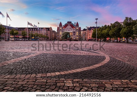 Big open square next to the Helsinki train station and bus station, Helsinki , Finland. - stock photo