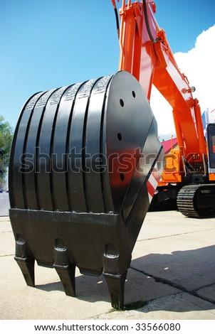 Big orange excavator - stock photo