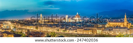 Big panorama of Florence at night in Italy - stock photo