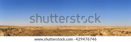 Big panorama of mountains in Negev desert in Israel with road - stock photo