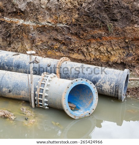 Big PE sewer pipe and flange installation in construction site - stock photo