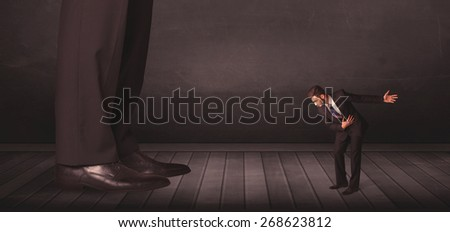 Big person with small businessman concept on background - stock photo