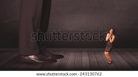 Big person with small businesswoman concept on background - stock photo
