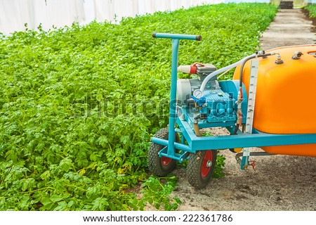 big pesticide sprayer in greenhouse close up - stock photo