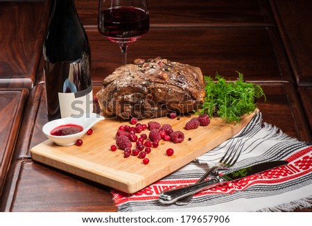 Big piece of fried lamb with sweet berry sauce - stock photo