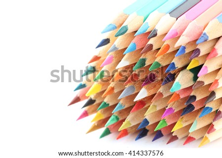Big pile of colored pencils isolated on white background - stock photo