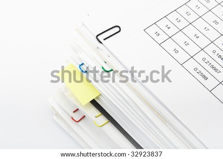 Big pile of different coloured office papers in files and folders on white background