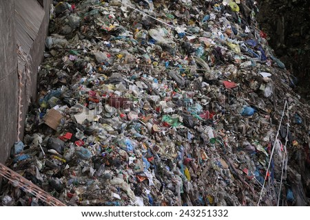 Big pile of garbage at a waste processing plant - stock photo