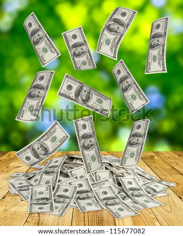big pile of money. dollars over green background - stock photo