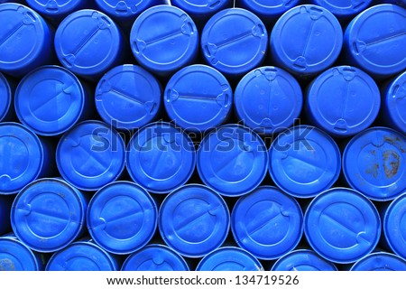 big pile of stacked blue barrels - stock photo