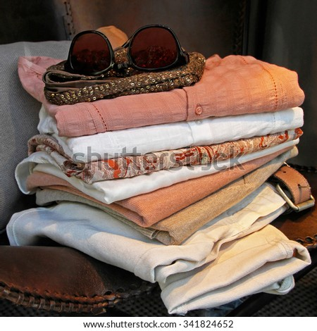 Big Pile of Summer Style Linen Clothing - stock photo