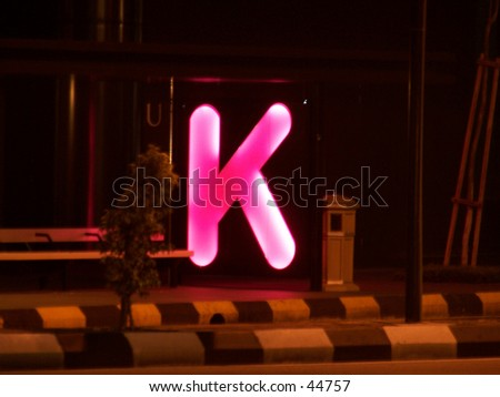 "Big pinky letter ""K"" near road side - stock photo"