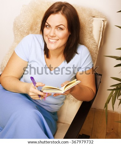 big pretty young woman at home resting, reading book