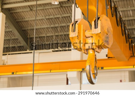 Big pulley hook hanging with sling  - stock photo