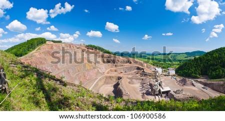 Big quarry under the blue sky - stock photo
