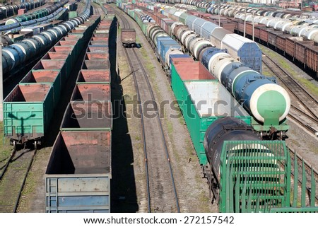 big railway cargo station junction with a lot of trains and track lines - stock photo