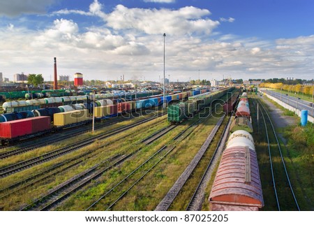 Big railway station with freight trains in sunny day - stock photo