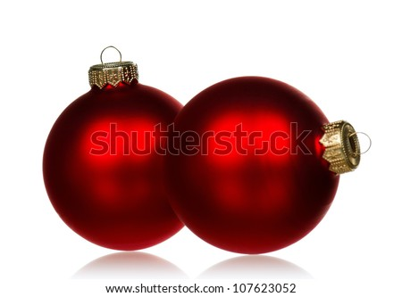 Big red baubles for christmas firtree on white background - stock photo