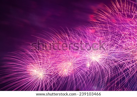 Big red fireworks in the night sky - stock photo