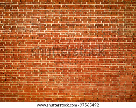 Big red grungy brick wall texture - stock photo