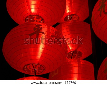 Big red lanterns with chinese letters printed - stock photo