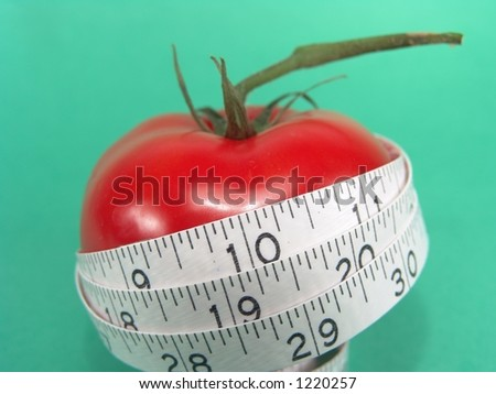 Big Red Tomato and Measuring Tape Representing Dieting and Fitness (Close-up with life-like colors)