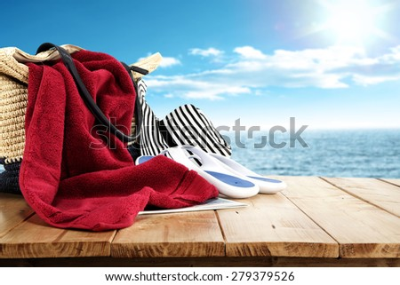 big red towel on bag and hat of summer time  - stock photo