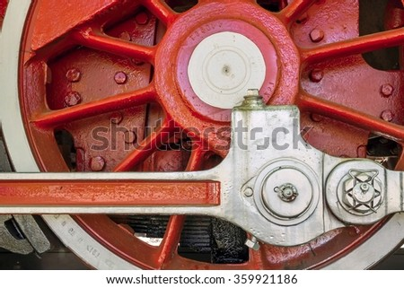 big red wheel a closeup of the old locomotive with the steam engine - stock photo