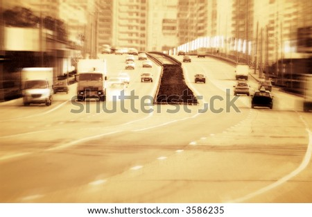 Big road with cars. Red tint, high contrast and motion blur to rise speed. - stock photo