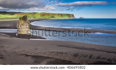 Big rock on the black beach, Iceland - stock photo