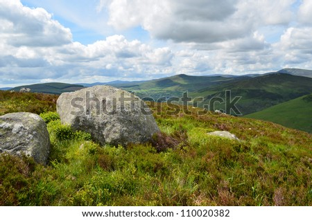 Big rocks in a typical green Irish landscape in Wicklow Mountains national park, south of Dublin in Ireland. - stock photo