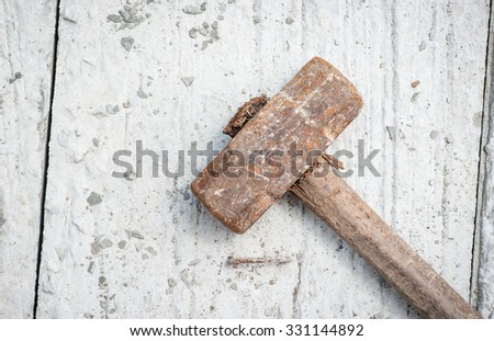 big rusty hammer on cement