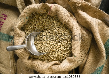 Big sack of coffee beans waiting to be roasted in roaster warehouse food drink production - stock photo