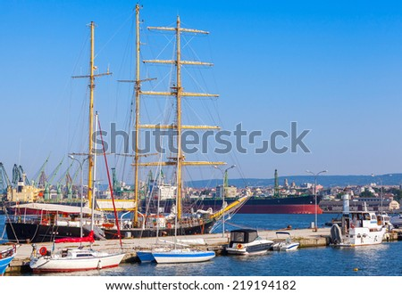 Big sailing ship and pleasure boats in port of Varna, Bulgaria - stock photo