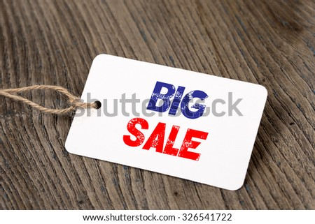 Big Sale on Tag on Wooden Background - stock photo