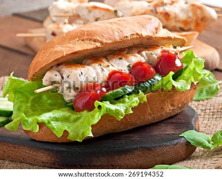 Big sandwich with chicken kebab and lettuce - stock photo