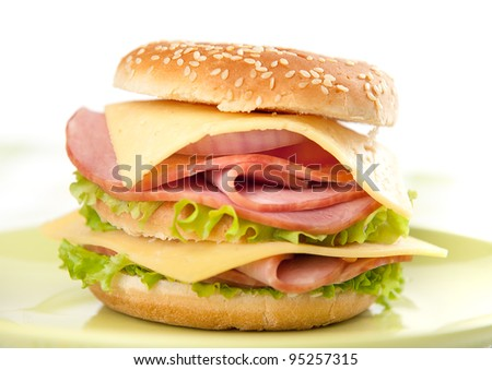 Big sandwich with lettuce, tomato, ham and cheese. Hamburger - stock photo