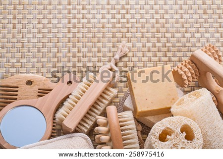 big set of bathroom accessories on wicker background with copyspace  - stock photo