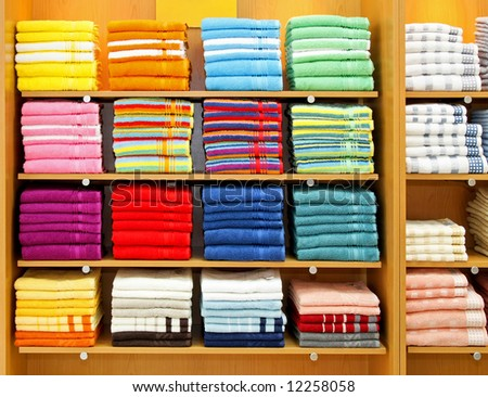 Big shelf with bunch of colorful towels - stock photo