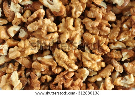 Big shelled walnuts background - stock photo