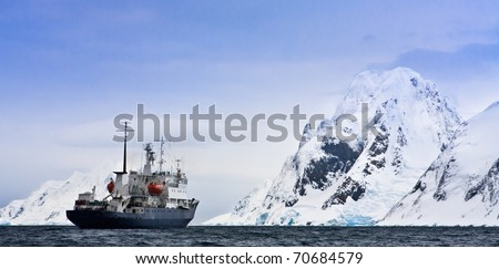 Big ship in Antarctic waters - stock photo