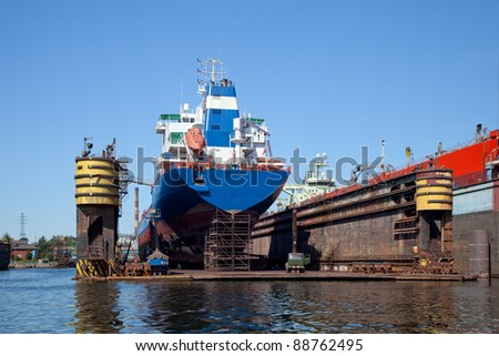 Big ship to dock at the shipyard. - stock photo