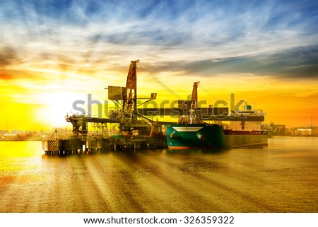 Big ship under loading coal in Port of Gdansk, Poland. - stock photo