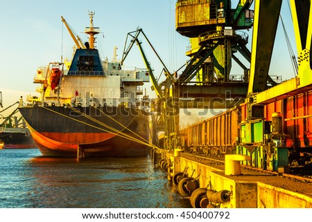 Big ship under unloading coal in Port of Gdansk, Poland. - stock photo